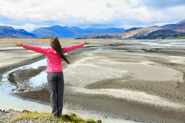 Wall Mural - Woman enjoying view of Iceland black sand dunes