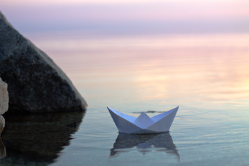 paper boat floating in the water