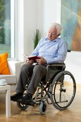 Elder man reading a book
