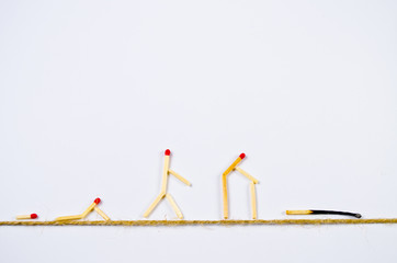 Human life cycle symbolized by matches