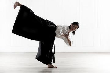 beautiful woman wearing a hakama engaged in Jiu Jitsu 8