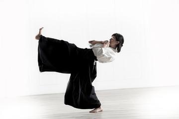 beautiful woman wearing a hakama engaged in Jiu Jitsu 4
