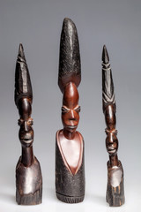 African wooden statuettes of women
