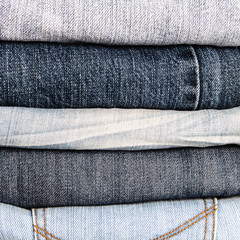 stacking of different blue jeans