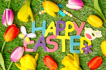 Wall Mural - Happy Easter ! Card with colorful flowers and text