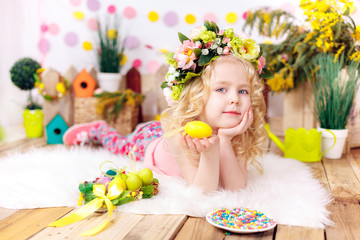 little girl with easter eggs, smiling, easter decor