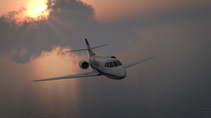 Business jet over ocean
