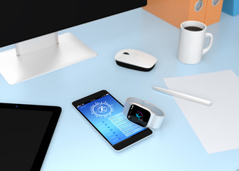Smart watch synchronizing fitness app with smart phone on table.