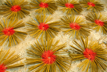 Incense sticks drying on the sun