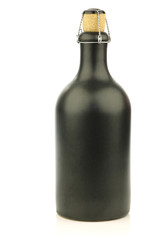 grey ceramic beer bottle with a cork