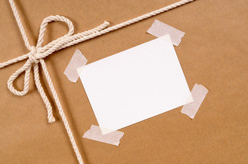 Brown paper package with untidy label