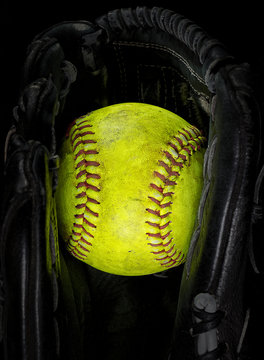 Old softball in a glove