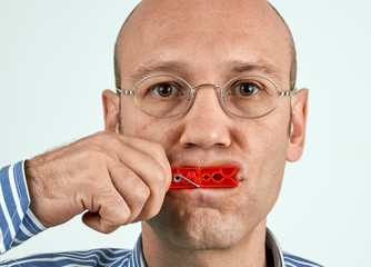 Man with mouth tightly closed
