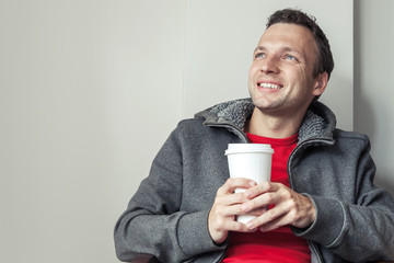 Caucasian man in cafe with paper cup of Coffee