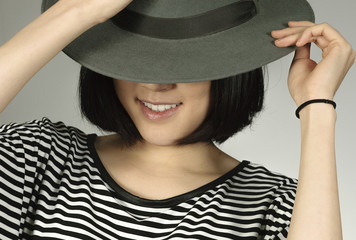Woman wears vintage hat