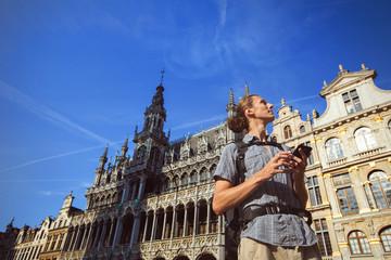 Man travel in Europe use map on navigator gps