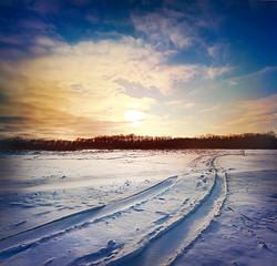Road through snowy field