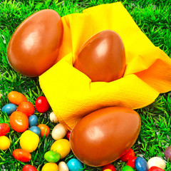 Three easter eggs on the green grass