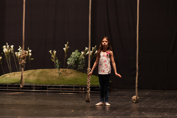 young girl performing at theater