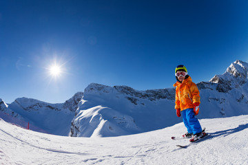 Fisheye view of boy skiing on mountain slope