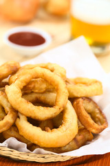 Homemade beer-battered onion rings in a basket