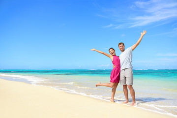 Wall Mural - Freedom on beach vacation - happy carefree couple
