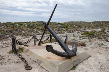 ship wreck ancor on a pedestal in coastal dunes