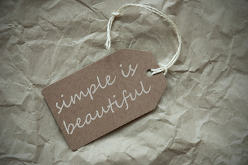 Beige Label With Quote Simple Is Beautiful Paper Background