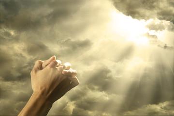 Prayer raised hands on the sky