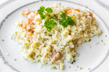 seafood risotto topped with parsley