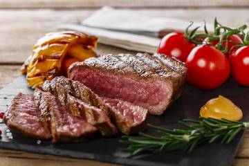 grilled beef steak rare sliced with vegetables