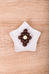 Chocolate star on a wooden background