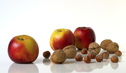 Group of apples fruits and nuts.