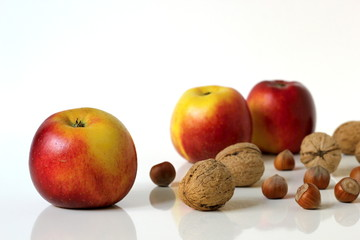 Apples fruits and nuts.
