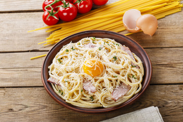 pasta carbonara on a plate with egg yolk and parmesan cheese