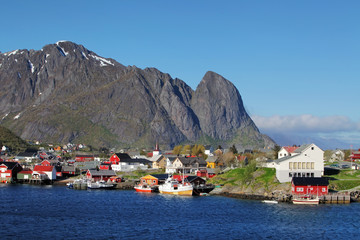 Wall Mural - Norwegian fishing village with traditional red rorbu huts, Reine