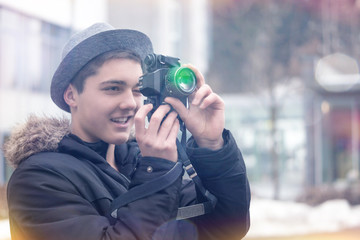 Young Man looking through Viewfinder of an old Camera
