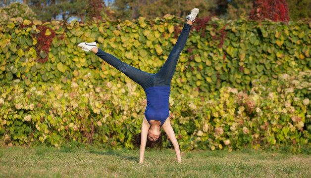 Sporty woman show cartwheel