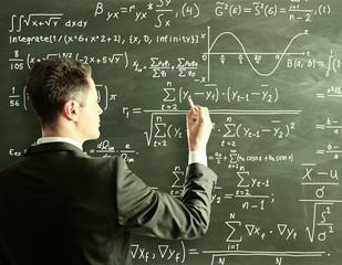 businessman writing formula
