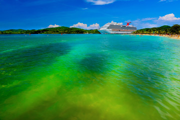 Luxury cruise ship near the beach