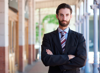 Handsome young businessman with beard