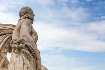Low angle view of a statue against cloudy sky, Barcelona
