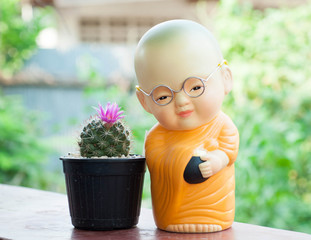 monk doll and cactus