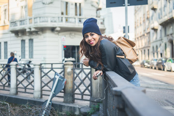 Beautiful girl posing in an urban context