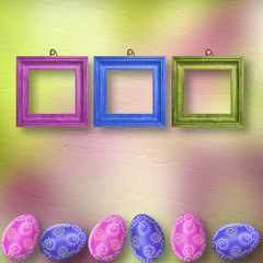 Drawing eggs  with wooden frame on pastel background