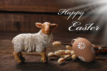 easter rustic decoration with lamb and egg on wooden background
