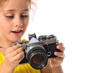 Blonde little girl holding a camera