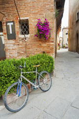 Fototapete - charming street in old town Pienza of Tuscany, Italy