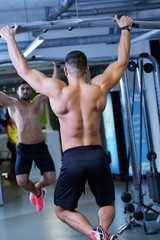 handsome man exercising at the gym