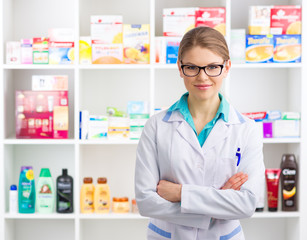 Confident woman pharmacist selling medicines and cosmetics